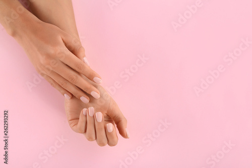 Fotografie, Obraz  Closeup view of woman with beautiful hands on color background, space for text