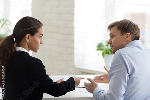 Fototapeta Conflict of female boss and male office worker