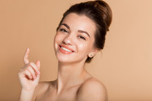 Happy Smiling Girl With Perfect Skin With Moisturizing Face Cream On A Cheek. Skin Care And Health Concept.