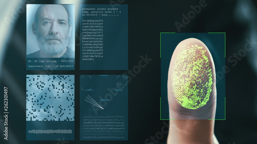 Futuristic digital processing of fingerprints as man holds his hand against a modern fingerprint scanner. Futuristic digital technology and transparent citizen concept.