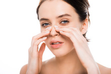 Beautiful Nude Woman Touching Nose After Rhinoplasty And Looking At Camera Isolated On White