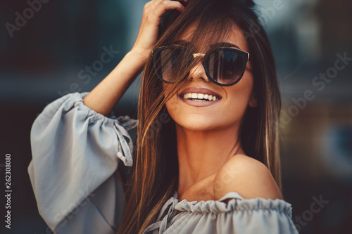 Portrait of a beautiful young woman in the city Wallpaper Mural