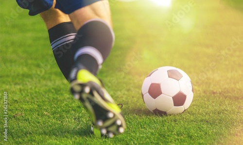 Running soccer player on grass
