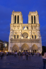 Notre Dame cathedral front in the early evening blue hours, Paris, France