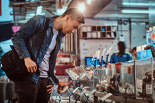 Young Asian Man Is Choosing Products At Market
