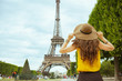 stylish solo tourist woman in Paris, France sightseeing