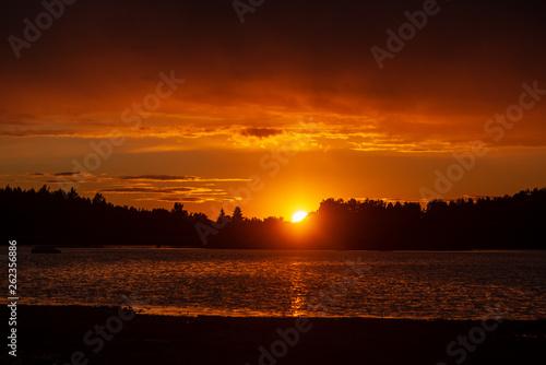 Garden Poster Brown dark red sunset over sea in evening