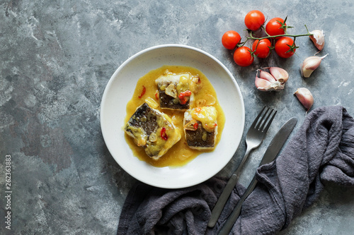 bacalao al pil pil, salted cod in emulsified olive oil sauce, spanish cuisine, basque country