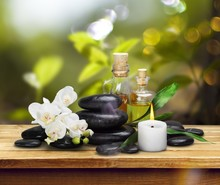 Zen Basalt Stones And Aroma Oil On The White