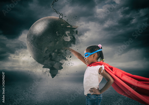 Fotografía Power and determination of a super hero child against a wrecking ball