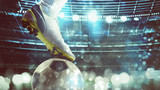 Fototapeta Sport - Close up of a soccer striker ready to kicks the ball at the stadium