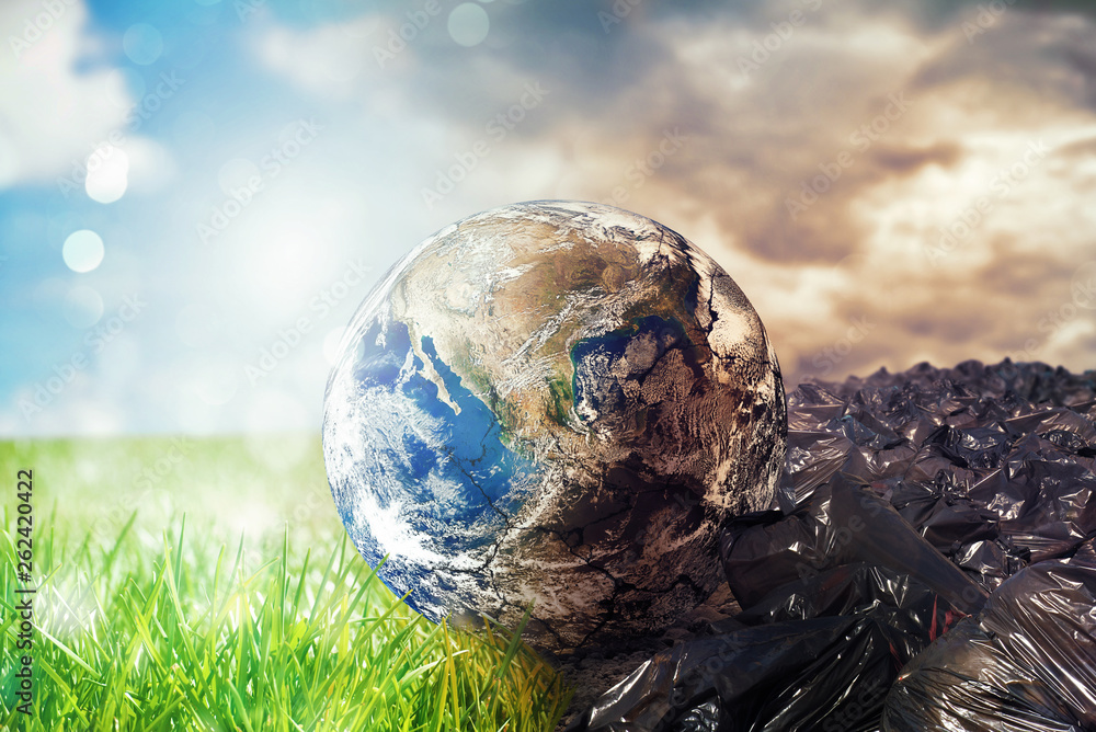 Fototapeta Earth is chancing due to pollution and undifferentiated trash. Save the World. World provided by NASA
