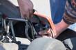 Locksmith repairing auto carting
