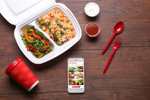 Flat Lay Composition With Smartphone And Takeout Meal On Wooden Background. Food Delivery