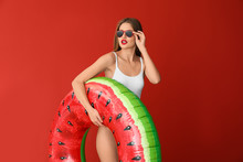 Beautiful Young Woman With Inflatable Ring On Color Background