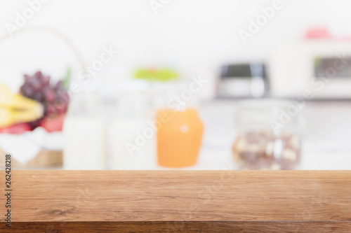Fotografie, Obraz  Empty wood table top and blurred kitchen interior background - can used for display or montage your products