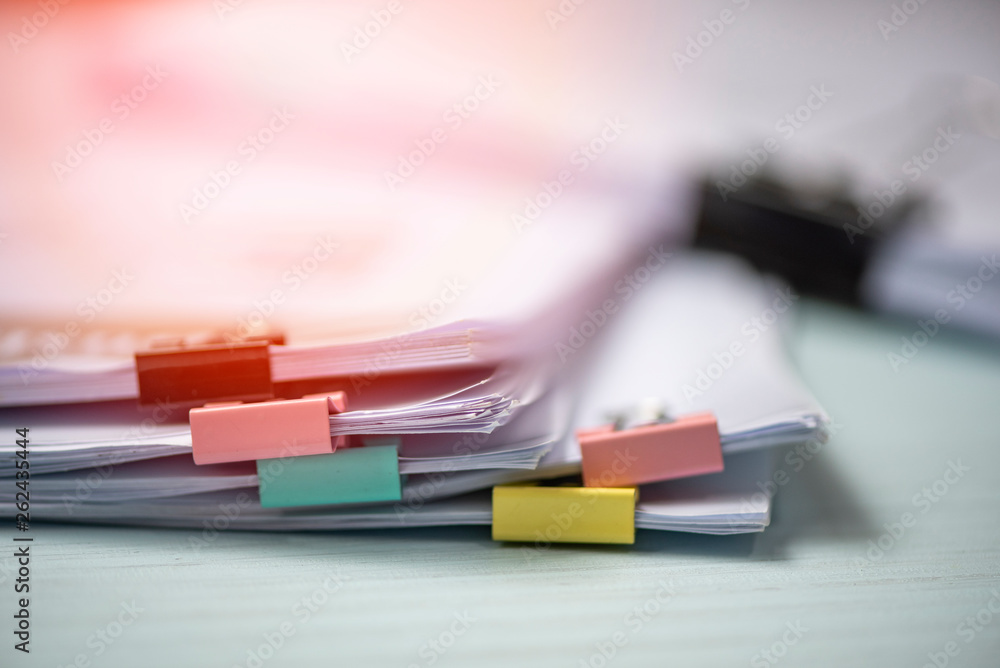 Fototapeta Report paper document present financial and business report with colorful paper clip