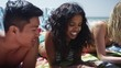 Close up portrait of young interracial friends lying on the beach