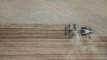 Tractor Plowing The Field. Agriculture Aerial Photography With Drone. Copyspace