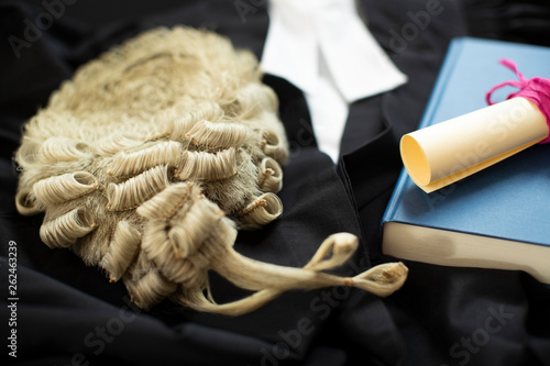 Photo Legal Concept Still Life Of Barristers Wig With Gown And Brief