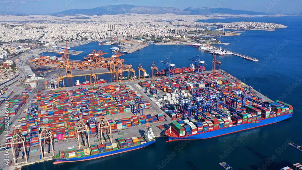 Fototapeta Aerial photo of industrial cargo container loading terminal located in mediterranean port