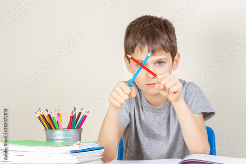 Sad angry boy have difficulties doing homework Wallpaper Mural
