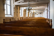 Interior of and old Lutheran church with rows of benches