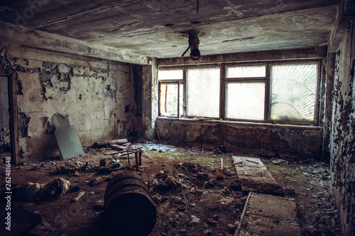 Abandoned ruined industrial building room inside interior, dark dirty grunge and Canvas Print