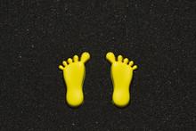 Yellow Footprint Shapes On Black Sand