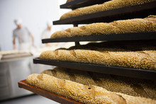 Freshly Baked Bread Baguettes In Bakery Workshop