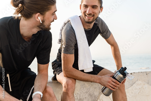Two healthy fit twin brothers exercising outdoors Wallpaper Mural