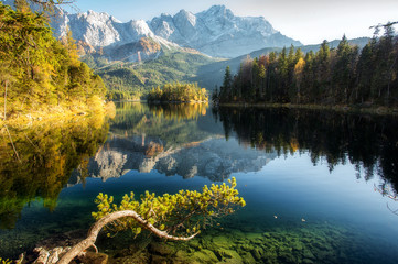 Fototapeta Rzeki i Jeziora Incredible Autumn landscape The Eibsee Lake in front of the Zugspitze under sunlight. Amazing sunny day on the mountain lake. top place for photography. Eibsee lake in Bavaria, Germany