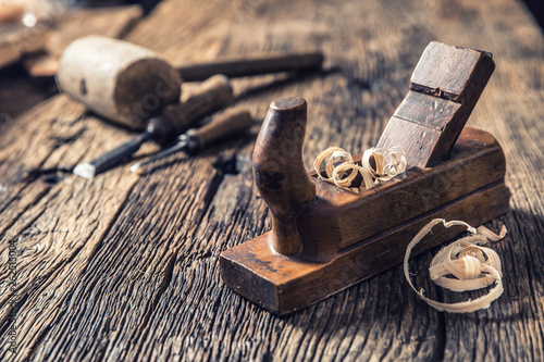 Fotografering Old planer and other vintage carpenter tools in a carpentry workshop