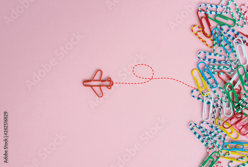 Fotomural  Business concept for group of stacked paperclip with another one red plane paper