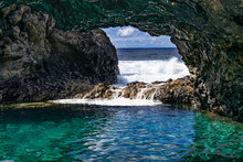 Charco Azul Volcanic Cavern, Natural Volcanic Ocean Pool With Turquoise Ocean Water In A Volcanic Cavern, With Sunlight And Atlantic Ocean Background, Frontera, El Hierro, Canary Islands, Spain