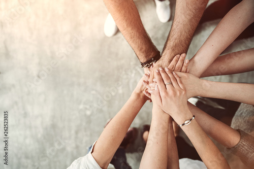 Teamwork, unity concept, group of friends put their hands together with copy space