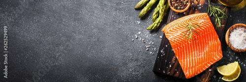 Fotografie, Obraz  Salmon fillet with ingredients for cooking -  fresh vegetables a