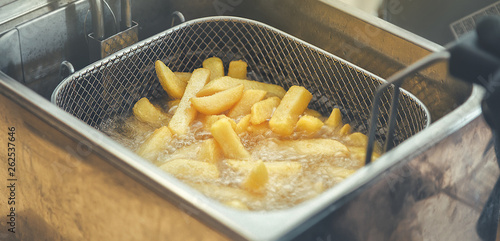 Fotografija French fries cooking