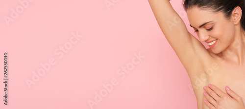Close up of female armpit isolated on pink background Canvas Print