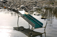 Sluice Or Washing Ramp In Situation In The Water To Search For Gold In The River