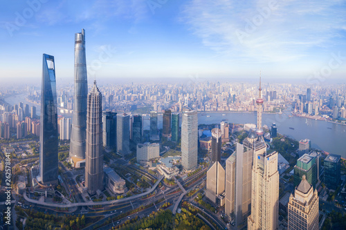Foto auf Gartenposter Shanghai Aerial view of The Pearl at Shanghai Downtown skyline by Huangpu River, China. Financial district and business centers in smart city in Asia. Skyscraper and high-rise buildings near The Bund at noon.