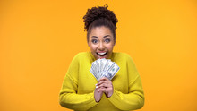 Excited Afro-American Woman Holding Bunch Of Dollars, Lottery Winner, Fortune