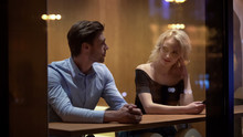 Pretty Female Flirting With Young Man At Cafe, Evening Time, Pick-up And Date