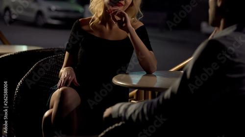 Attractive blond female seducing man on restaurant terrace, escort service Wallpaper Mural