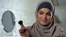 Beautiful Arab Woman Applying ...