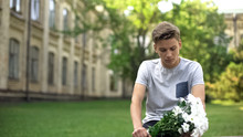 Upset Teenager With Bouquet Of...