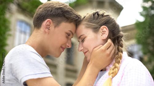 Fotografia  Tender boyfriend gently touching girlfriends face, feeling happy to find love