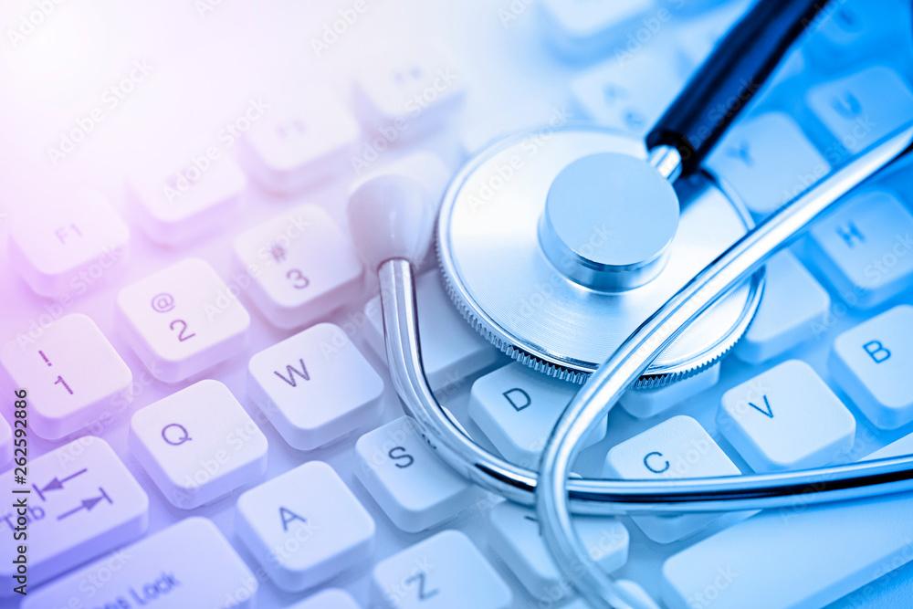 Fototapety, obrazy: Stethoscope on computer keyboard