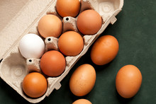 Close-up View Of Raw Chicken Eggs Brown And White In Box, Egg White, Egg Brown On Green Background