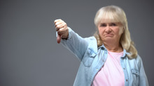 Unhappy Aged Lady Showing Thumbs-down Gesture, Unhappy With State Government
